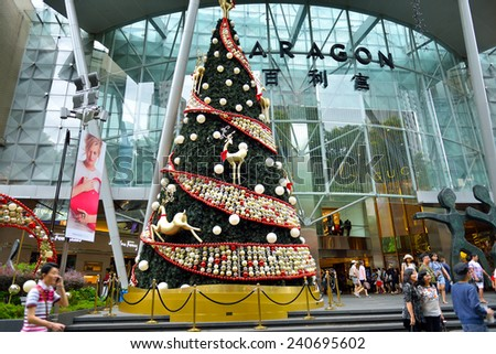 SINGAPORE - DEC 29:Night view of Christmas Decoration at Singapore Orchard Road on December 29, 2014 in Singapore. The street with colourful christmas trees, ball, stars & dressed-up shopping centres. - stock photo