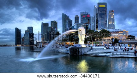 SINGAPORE-DEC 29: The Merlion fountain and Singapore skyline on Dec. 29, 2010. Merlion is an imaginary creature with head of a lion and the body of a fish and is often seen as a symbol of Singapore. - stock photo
