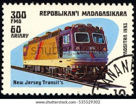 SINGAPORE  DECEMBER 14, 2016: A stamp printed in Madagascar shows locomotive, circa 1993