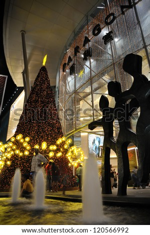SINGAPORE - DECEMBER 1: Christmas Decoration at Singapore Orchard Road on December 1, 2012 in Singapore. The street with twinkling lights and dressed-up shopping centre. - stock photo
