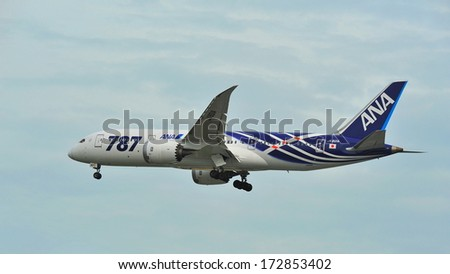 SINGAPORE - DECEMBER 25:  First Boeing 787 (Dreamliner) of All Nippon Airways (ANA) fleet landing at Changi Airport on December 25, 2013 in Singapore - stock photo