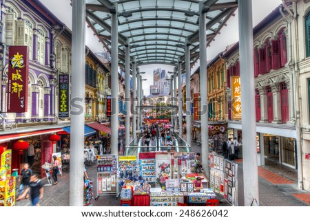 SINGAPORE-DECEMBER 15: People stroll along Chinatown's Pagoda Street December 15, 2014. Low-rise, Baroque-Victorian style shops and restaurants are a distinct trademark of the popular area. - stock photo