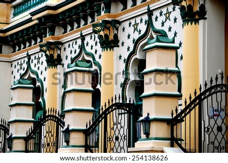 Singapore - December 17, 2007: Saracen columns and iron gates enclose the ornate facade decorated with stars at the 1907 Masjid Abdul Gaffoor Mosque in Little India - stock photo