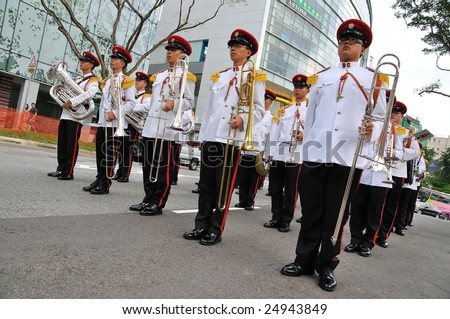 SINGAPORE - DECEMBER 07: Singapore Armed Forces Band B standing still during President's changing of guards parade December 07, 2008 in Singapore - stock photo