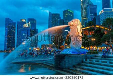 SINGAPORE - DECEMBER 22: The Merlion fountain lit up at night on December 22, 2013 in Singapore. - stock photo
