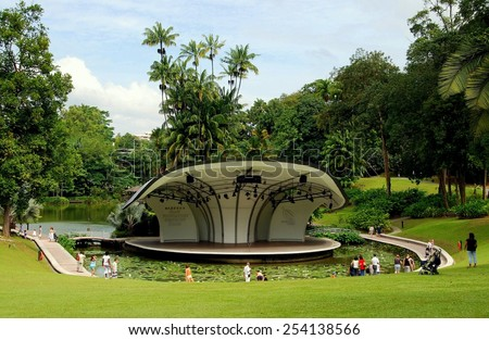 Singapore - December 22, 2007:  The Shaw Foundation Symphony Stage surrounded by a moat filled with lily pads is used for outdoor concerts at the Singapore Botanic Gardens - stock photo