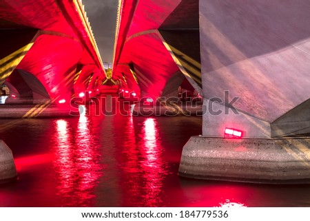 SINGAPORE - December 3, 2013: The view under Esplanade bridge in Singapore during a light show with the color red. - stock photo