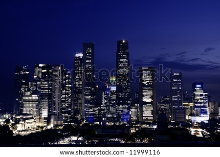 Singapore downtown at dusk (city skyscrapers night view) - stock photo