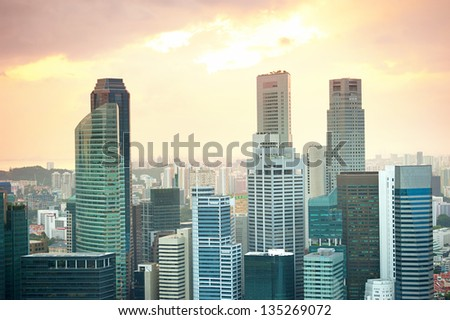 Singapore downtown in the colorful sunset - stock photo