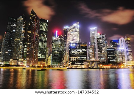 Singapore downtown reflecting in the river - stock photo