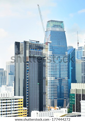 Singapore downtown with a construction site in progress - stock photo