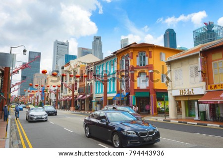 SINGAPORE - FEB 17, 2017: Busy traffic on a road in Chinatown in Singapore. Chinatown is an ethnic enclave located within the Outram district in the Central Area of Singapore.