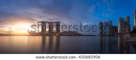 SINGAPORE - FEB 24, 2016: Cityscape panorama of Singapore city skyline with Marina Bay Sands hotel and ferris wheel at sunrise in Marina Bay - stock photo