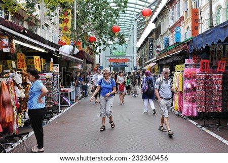 SINGAPORE - FEB 11: Shoppers walk through a Chinatown market during Chinese New Year celebrations on Feb 11, 2012 in Singapore. The city state's ethnic Chinese began settling in Chinatown circa 1820s.