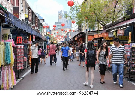 SINGAPORE - FEB 11: Shoppers walk through Chinatown as Singapore welcomes in Chinese New Year on Feb 11, 2012 in Singapore. The city state's ethnic Chinese began settling in Chinatown circa 1820s. - stock photo