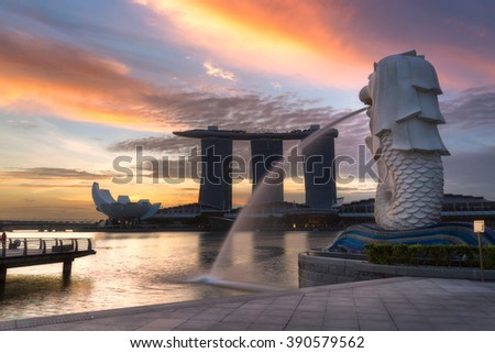 SINGAPORE - FEB 24, 2016: The Merlion fountain and Marina Bay Sands hotel in sunrise. This famous place in Singapore. - stock photo