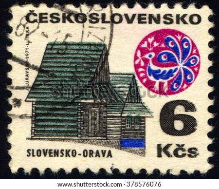 "SINGAPORE - FEBRUARY 19,  2016: A stamp printed in Czechoslovakia shows Cottages, Orava, with the same inscription, from the series ""Czechoslovakia Regional Buildings"", circa 1971 - stock photo"