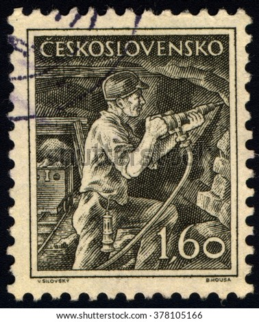 SINGAPORE - FEBRUARY 18,  2016: A stamp printed in Czechoslovakia shows miner, circa 1954. - stock photo