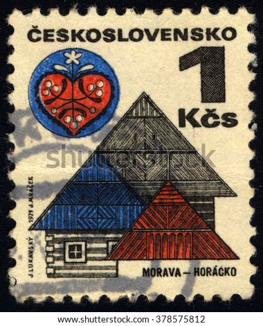 SINGAPORE - FEBRUARY 19,  2016: A stamp printed in Czechoslovakia shows wooden houses in Horaco, Moravia, circa 1971