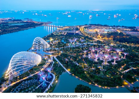 SINGAPORE - February 22 2015: Aerial night view of The Supertree Grove at Gardens near Marina Bay. Gardens by Bay was crowned World Building of Year at World Architecture Festival 2012 - stock photo