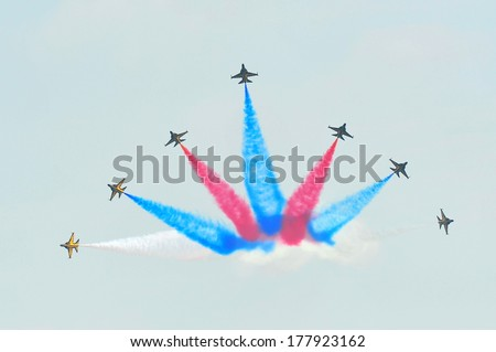 SINGAPORE - FEBRUARY 9: Aerobatic flying display by Black Eagles from the Republic of Korean Air Force (ROKAF) at Singapore Airshow February 9, 2014 in Singapore - stock photo