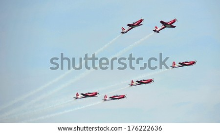 SINGAPORE - FEBRUARY 9: Aerobatic flying display by TNI-AU Jupiter Aerobatic Team from Indonesia at Singapore Airshow February 9, 2014 in Singapore - stock photo