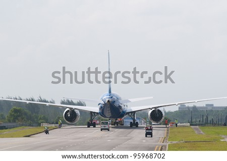 SINGAPORE - FEBRUARY 14: Boeing 787 Dreamliner being towed at Singapore Airshow in Singapore on February 14, 2012. - stock photo