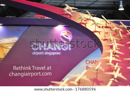 "SINGAPORE - FEBRUARY 9: Booth of Changi Airport Group (CAG) with ""Rethink Travel"" slogan at Singapore Airshow February 9, 2014 in Singapore - stock photo"
