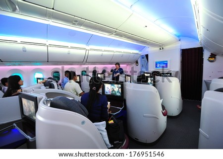 SINGAPORE - FEBRUARY 12: Briefing in the business class cabin onboard Qatar Airways Boeing 787-8 Dreamliner at Singapore Airshow February 12, 2014 in Singapore