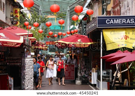 SINGAPORE - FEBRUARY 3: Bustling street of Chinatown district on February 3, 2009 in Singapore. Singapore's Chinatown is a world famous bargain shopping destination. - stock photo