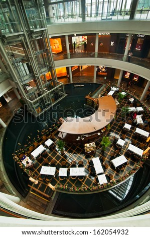 SINGAPORE - FEBRUARY 26: Cafe at Marina Bay Sands Resort on Febr 26. With most expensive boutiques, restaurants, casino. Attractive for fashion business and lux shopping in fast developing Asian city - stock photo