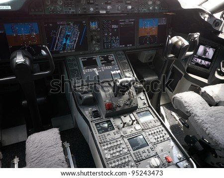 SINGAPORE - FEBRUARY 14: Cockpit of Boeing 787 Dreamliner during Singapore Airshow at Changi Exhibition Centre in Singapore on February 14, 2012. - stock photo