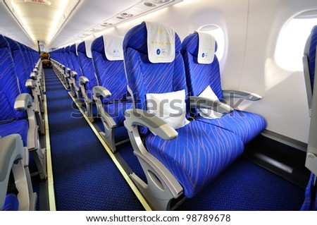 SINGAPORE - FEBRUARY 17: Economy cabin of China Southern Airlines Embraer 190 at Singapore Airshow February 17, 2012 in Singapore