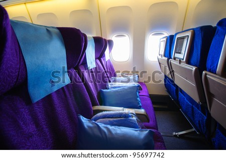 SINGAPORE - FEBRUARY 12: Economy class cabin in Singapore Airlines' (SIA) last Boeing 747-400 aircraft at Singapore Airshow February 12, 2012 in Singapore - stock photo