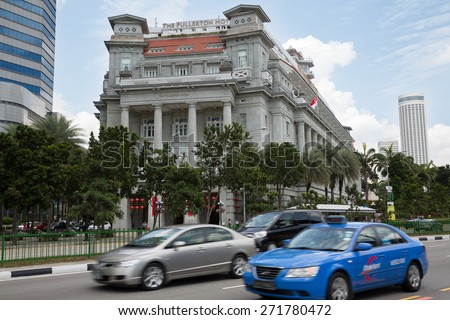 SINGAPORE - FEBRUARY 18, 2015: Famous The Fullerton Hotel in Singapore is a five-star luxury hotel located on the Fullerton Road. Commissioned in 1919. - stock photo