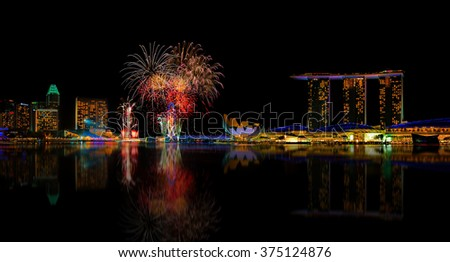SINGAPORE  - FEBRUARY 9: Fireworks by Marina Bay Sands, an integrated resort fronting Marina Bay, February 9, 2016, Singapore. The world's most expensive standalone casino property. - stock photo