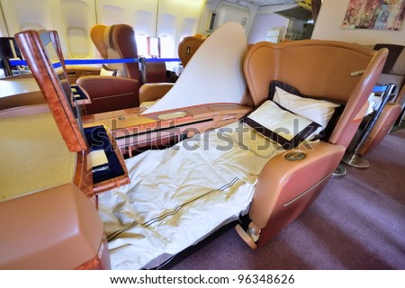 SINGAPORE - FEBRUARY 17: First class cabin bed in Singapore Airlines' (SIA) last Boeing 747-400 aircraft at Singapore Airshow on February 17, 2012 in Singapore - stock photo