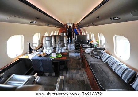SINGAPORE - FEBRUARY 12: Luxurious interior of Bombardier Global 6000 executive jet at Singapore Airshow February 12, 2014 in Singapore - stock photo