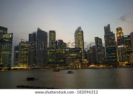 SINGAPORE - FEBRUARY 28: Marina Bay at sunset on February 28, 2014 in Singapore. The night view of Singapore is especially spectacular seen from Marina Bay. - stock photo