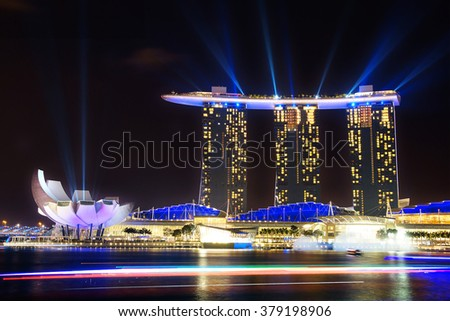 SINGAPORE - FEBRUARY 03, 2014: Marina Bay Sands at night during Light and Water Show 'Wonder Full' . It opened on 27 April 2010. Designed by architect Moshe Safdie.