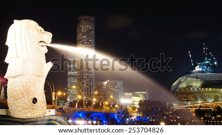 SINGAPORE - FEBRUARY 03, 2014:Merlion in Merlion Park at night.Merlion is a mythical creature with the head of a lion and the body of a fish,used as a mascot and national personification of Singapore  - stock photo