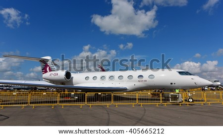 SINGAPORE - FEBRUARY 16:  Qatar Executive Gulfstream G650 business jet on display at Singapore Airshow February 16, 2016 in Singapore - stock photo