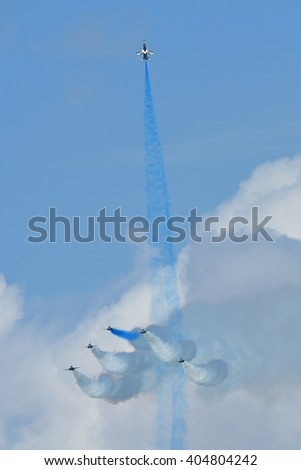 SINGAPORE - FEBRUARY 16:  RKAF Black Eagles Aerobatic Team aerobatic performance at Singapore Airshow February 16, 2016 in Singapore
