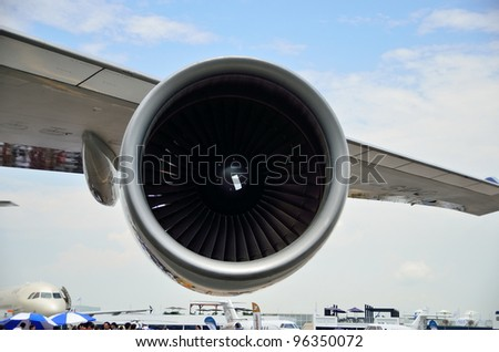 SINGAPORE - FEBRUARY 17: Side profile of Singapore Airlines' (SIA) Boeing 747-400 jet engine at Singapore Airshow on February 17, 2012 in Singapore - stock photo
