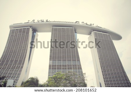 SINGAPORE-FEBRUARY 14: The Marina Bay Sands Resort Hotel on February 14, 2014 in Singapore. It is an integrated resort and the world's most expensive standalone casino property at S$8 billion