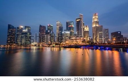 SINGAPORE-FEBRUARY 16: The Singapore skyline in twilight time on February 16,2015. Singapore is the 14th largest exporter and the 15th largest importer in the world - stock photo