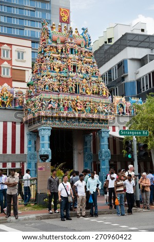 SINGAPORE - FEBRUARY 18, 2015: The Sri Veerama Kaliamman Temple in ethnic district Little India in Singapore. Little India is commonly known as Tekka in the local Tamil community. - stock photo