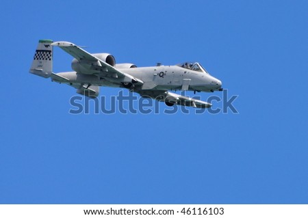 SINGAPORE - FEBRUARY 03: USAF A-10 Thunderbolt II performing stunts during Singapore Airshow February 03, 2010 in Singapore - stock photo