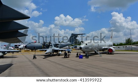 SINGAPORE - FEBRUARY 16: USAF Boeing C-17 Globemaster III, USN Boeing F/A-18E/F Super Hornet and USN Boeing P-8 Poseidon on display at Singapore Airshow February 16, 2016 in Singapore - stock photo