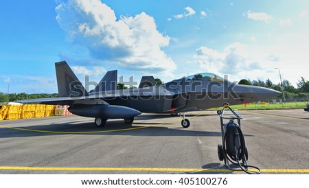 SINGAPORE - FEBRUARY 16:  USAF Lockheed Martin F22 Raptor on display at Singapore Airshow February 16, 2016 in Singapore - stock photo